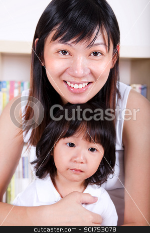 Mother and daughter stock photo, Happy young Asian mother and her daughter. by szefei