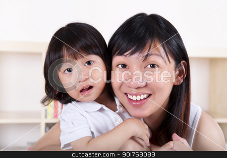 Mother and daughter. stock photo, Portrait of young Asian mother and her daughter. by szefei