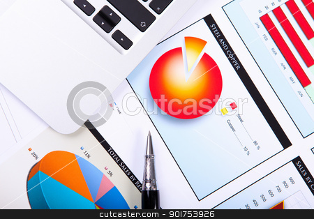 Financial papers on the table stock photo, Financial paper charts and graphs on the table by Sergey Nivens