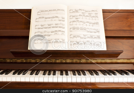 piano with score stock photo, front view of a open piano with score by Lutya