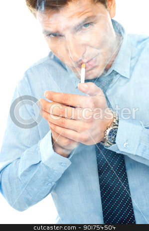 Young man lighting a cigarette stock photo, Young man lighting a cigarette against white background by Ishay Botbol