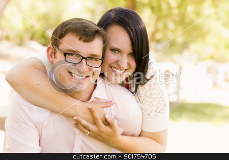 Young Couple Having Fun in the Park stock photo, Attractive Young Couple Having Fun Outside in the Park by Andy Dean