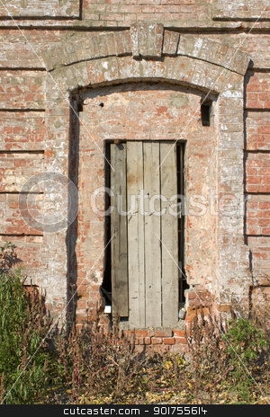 The closed door. stock photo, Old brick tower. by Yury Ponomarev