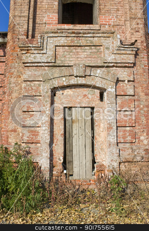 Old brick tower. stock photo, Window and closed door in an old building. by Yury Ponomarev
