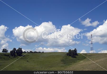 Telecommunication pillar. stock photo, Telecommunication tower on the green field with blue sky. by Yury Ponomarev
