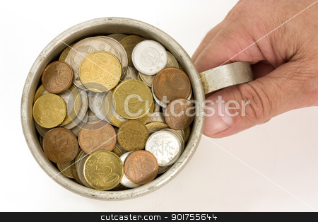 Old aluminum mug and coins. stock photo, The Male hand and aluminum mug with money. by Yury Ponomarev