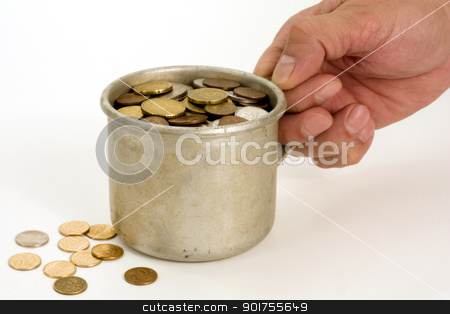 Old aluminum mug and coins. stock photo, The Male hand keeps get old aluminum mug with money. by Yury Ponomarev