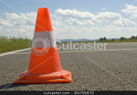 Cone on a road. stock photo, Warning road mark on a road. by Yury Ponomarev
