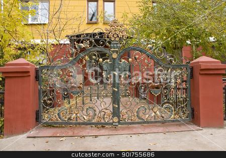 Decorative metal gate. stock photo, Flower ornament on a metal decorative gate. by Yury Ponomarev