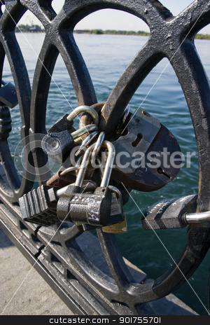 Locks on a lattice. stock photo, Metal lattice with locks. by Yury Ponomarev