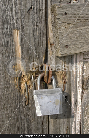 The old lock. stock photo, The old lock at an old wooden door. by Yury Ponomarev