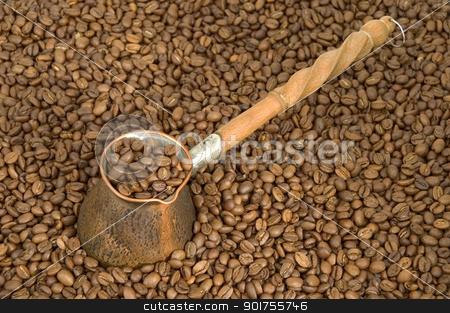 Turkish coffee pot. stock photo, Turkish coffee pot and coffee beans. by Yury Ponomarev