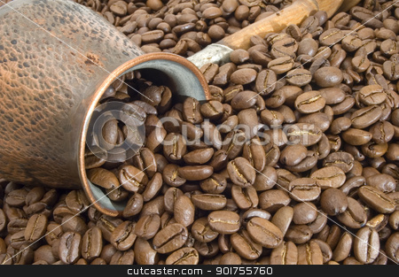Turkish coffee pot. stock photo, Turkish coffee pot on a background of coffee grains. by Yury Ponomarev