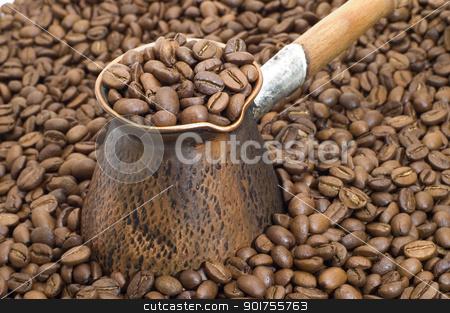 Turkish coffee pot. stock photo, Turkish coffee pot on a background of coffee grains. by Yury Ponomarev