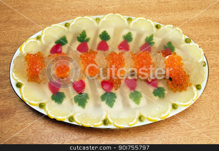 Jellied fish with caviar. stock photo, The large dish with appetizer on a background of a light tree by Yury Ponomarev