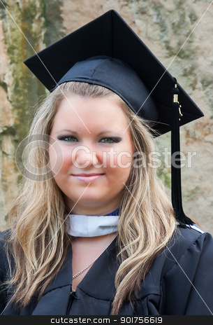 Female College Graduate in Cap and Gown stock photo, Portrait of a female college graduate on graduation day. She is wearing a graduation cap and gown. by Stephen Bonk