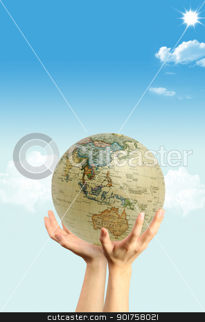 Hands and globe stock photo, Hands and globe on the sky by Diana
