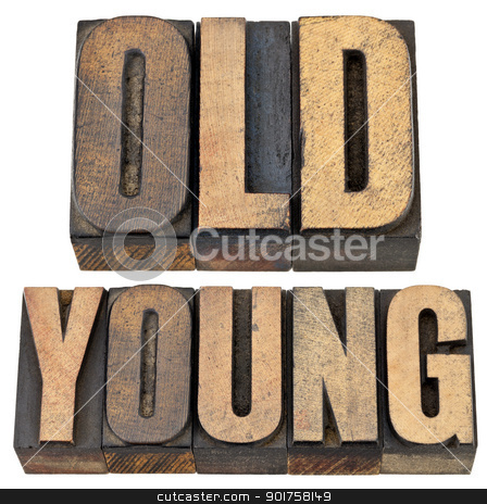 old and young in letterpress wood type stock photo, old and young antonym - age or generations concept -- isolated text in vintage letterpress wood type by Marek Uliasz