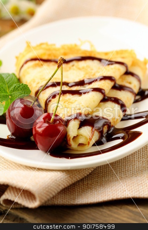 Sweet pancake with chocolate sauce and cherries stock photo, Sweet pancake with chocolate sauce and cherries by Olga Kriger