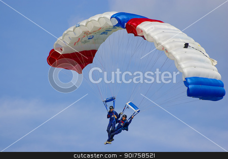Two parachutists stock photo, Two parachutists glide down to earth pairwise in the course of an air show, Metzingen, Germany, Sep 11, 2010. For editorial use only. by Ansebach
