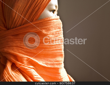 Islamic woman stock photo, Close-up of a Islamic woman covered with a orange veil  by szefei