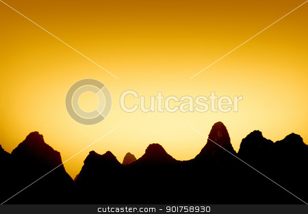 silhouette of mountains stock photo, silhouette of mountains in sunset  by szefei