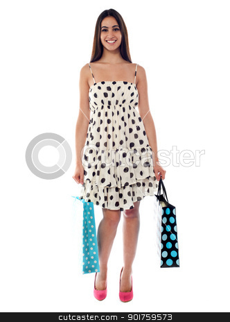 Shopping woman holding bags stock photo, Shopping woman holding bags. Full length shot against white background by Ishay Botbol
