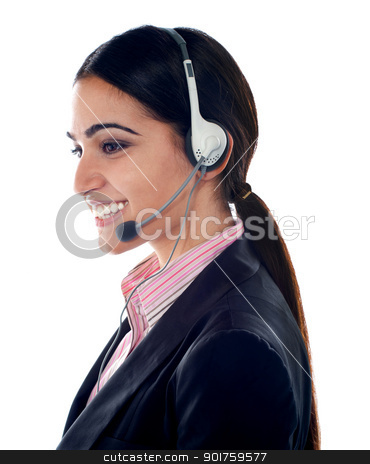 Pretty female customer care executive stock photo, Side pose of pretty female customer care executive wearing headsets by Ishay Botbol