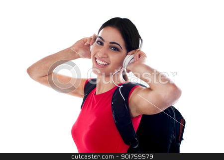 Trendy casual girl listening to music stock photo, Trendy casual girl listening to music. Enjoying herself by Ishay Botbol