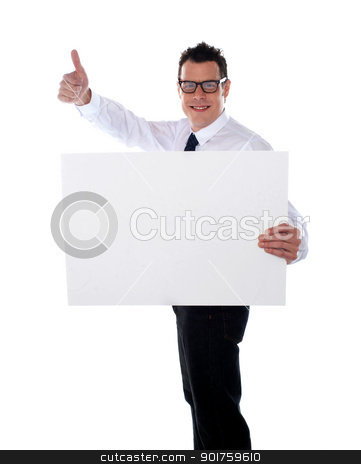 Thumbs up businessman holding banner ad stock photo, Thumbs up businessman holding banner ad isolated over white by Ishay Botbol