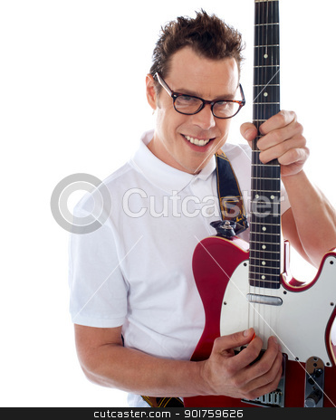 Closeup of a male guitarist stock photo, Attractive male guitarist playing guitar against white background by Ishay Botbol