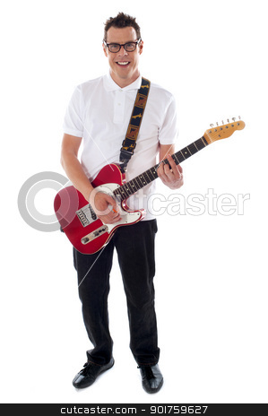 Full shot of a young man with guitar stock photo, Portrait of a man with guitar isolated on white background. Full length shot by Ishay Botbol
