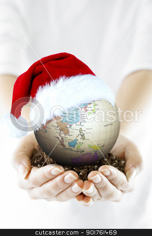 Merry Christmas and globe stock photo, Merry Christmas and globe on hands by Diana