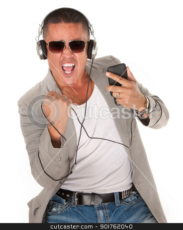 Listening to Something Good stock photo, Native American Man dances to music from his MP3 player by Scott Griessel