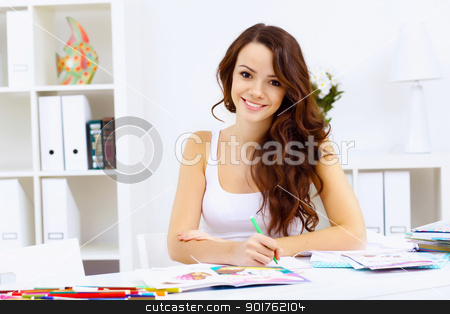 Student girl stock photo, Student girl studying her lessons at home by Sergey Nivens