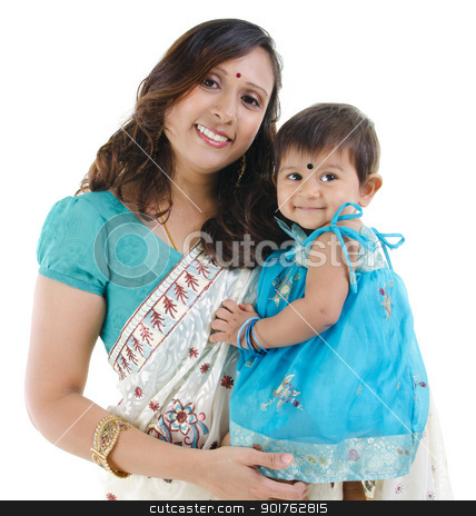 Indian mother and baby girl stock photo, Traditional Indian mother and her baby girl isolated on white background by szefei