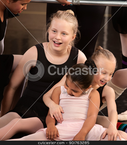 Girls Laughing at Ballet Class stock photo, Group of ballet students goofing off in class by Scott Griessel