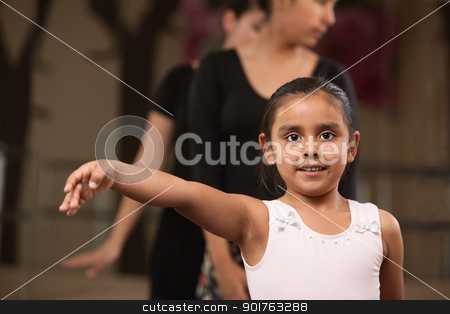 Proud Little Ballerina stock photo, Cute young ballet student practicing in a dance studio by Scott Griessel