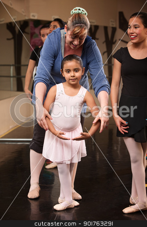Instructor with Young Dancer stock photo, Ballet class instructor helps young student with fourth position by Scott Griessel