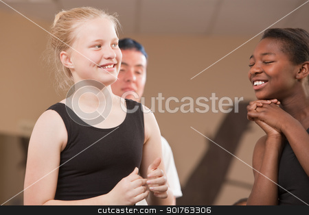 Happy Dance Students stock photo, Young ballet students laughing together at dance class by Scott Griessel