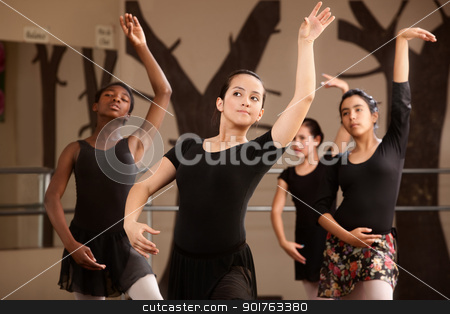 Group of Young Ballerinas stock photo, Four cute Black and Latina dance students rehearsing by Scott Griessel