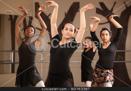 Ballet Students Practicing stock photo, Group of serious ballet dance students performing by Scott Griessel