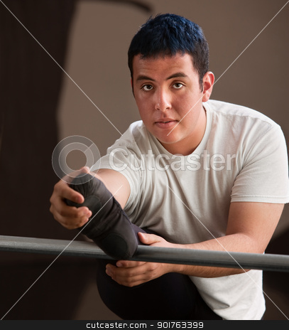 Young Dancer Stretching stock photo, Young man stretches his leg on railing by Scott Griessel