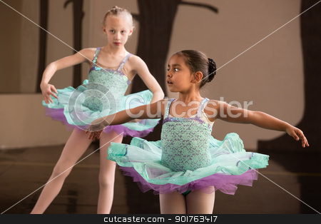 Cute Ballet Students Twirling stock photo, Two adorable children twirling during ballet practice by Scott Griessel