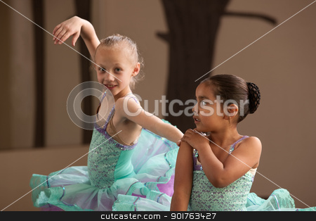Ballet Students Helping Each Other stock photo, Little ballet balances holding partner's shoulder during practice by Scott Griessel