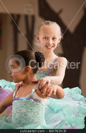 Young Dancer Helps Partner stock photo, Cute child ballet student helps her partner during rehearsal by Scott Griessel