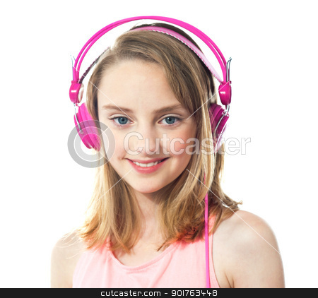 Attractive girl wearing pink headphones stock photo, Closeup of smiling girl wearing pink headphones isolated on white background. Closeup shot by Ishay Botbol