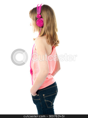 Its time for some music stock photo, Side shot of pretty young female enjoying music through headphones by Ishay Botbol