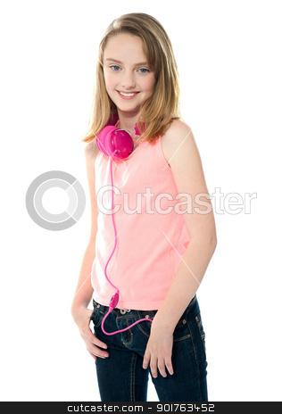 Stylish trendy girl with headphones stock photo, Stylish trendy girl with headphones around her neck by Ishay Botbol