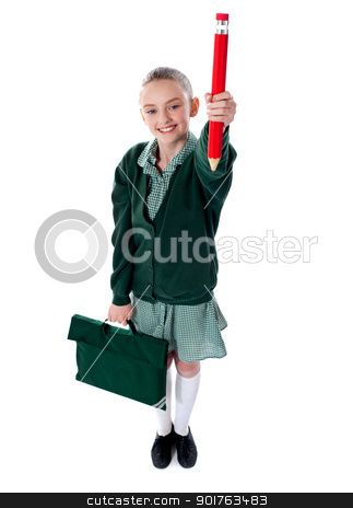 Full length shot of school girl with bag stock photo, Girl with school bag showing big showing red pencil to camera by Ishay Botbol